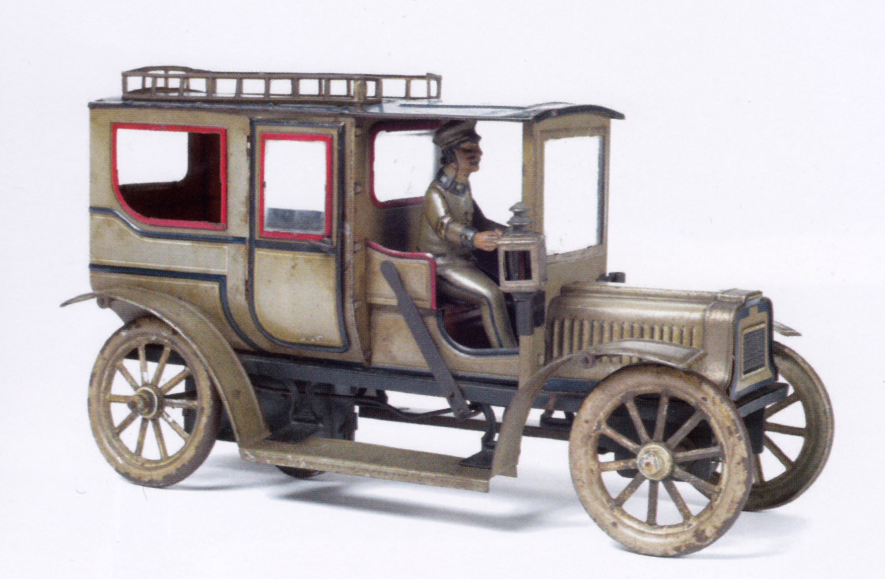 Limousine avec chauffeur en tôle peinte et lithographiée, Maison Carette, L. 31 cm